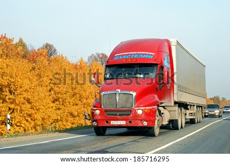 CHELYABINSK REGION, RUSSIA - OCTOBER 4, 2008: Red Kenworth T2000 semi-trailer truck at the interurban road. - stock photo