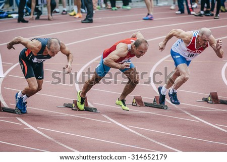 Chelyabinsk, Russia - August 28, 2015:  old men start at 100 meters during championship of Russia on track and field athletics among the elderly, Chelyabinsk, Russia - August 28, 2015 - stock photo
