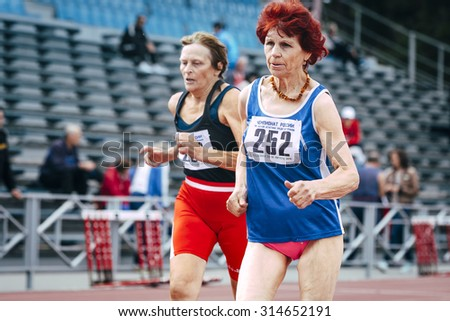 Chelyabinsk, Russia - August 28, 2015:  70 years old women run 100 meters during championship of Russia on track and field athletics among the elderly, Chelyabinsk, Russia - August 28, 2015 - stock photo