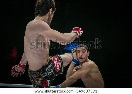 Chelyabinsk, Russia - December 5, 2015: athlete mixed martial arts fighter strikes his foot on head of his opponent during Cup of Russia MMA - stock photo