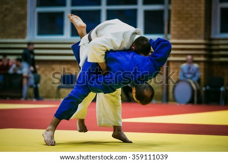 Chelyabinsk, Russia -  December 20, 2015: athletes judoists men during fight in judo during All-Russian competition on judo of memory Grigory Verichev - stock photo