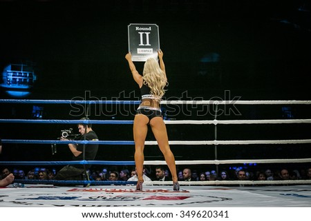 Chelyabinsk, Russia - December 5, 2015: beautiful sexy girl in ring, his back is facing table shows number of round during Cup of Russia MMA - stock photo