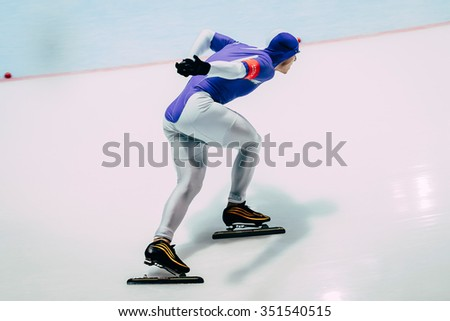 Chelyabinsk; Russia - December 3; 2015: closeup man athlete speedskater on track sprint race during Cup of Russia on speed skating