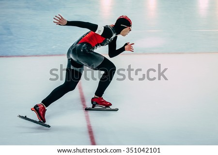 Chelyabinsk; Russia - December 3; 2015: closeup side view of female athlete running track speed skater during Cup of Russia on speed skating