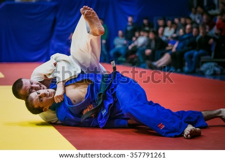Chelyabinsk, Russia -  December 20, 2015: fight on tatami two athletes wrestlers in finals during All-Russian competition on judo of memory Grigory Verichev - stock photo