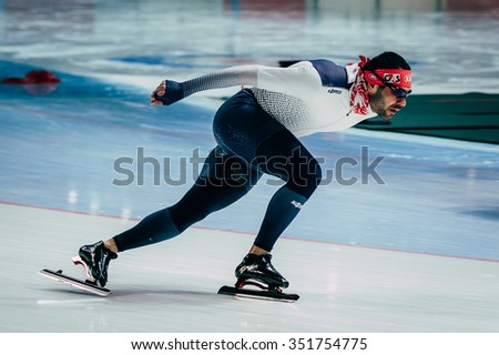 Chelyabinsk; Russia - December 3; 2015: man athlete speedskater warming up before race sprint distance during Cup of Russia on speed skating