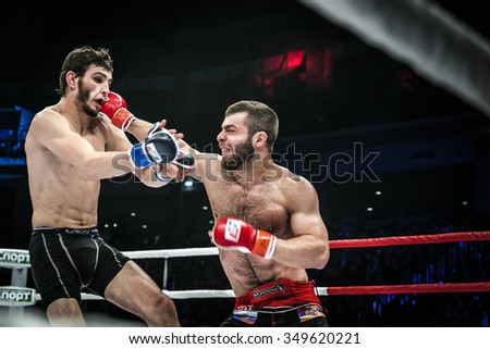 Chelyabinsk, Russia - December 5, 2015: MMA fighter gets a direct kick in head by his opponent during Cup of Russia MMA - stock photo