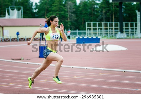 Chelyabinsk, Russia - July 05, 2015: girl athlete running a sprint race during Championship of Russia on track and field athletics among blind - stock photo