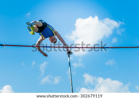 Chelyabinsk, Russia - July 24, 2015: men athletes pole vault during National competitions in memory of G. I. Nicewhen athletics - stock photo