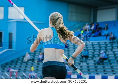 Chelyabinsk, Russia - July 24, 2015:  pole vault girl is preparing for attempt during National competitions in memory of G. I. Nicewhen athletics - stock photo