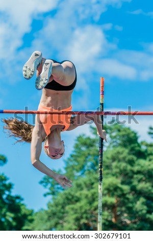 Chelyabinsk, Russia - July 24, 2015: young girl athlete performs a successful attempt in pole vault during National competitions in memory of G. I. Nicewhen athletics - stock photo