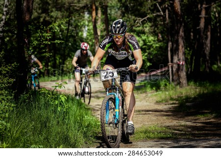 """Chelyabinsk, Russia - May 31, 2015: A mountain biker competes during the race """"New Energy 2015"""" - stock photo"""