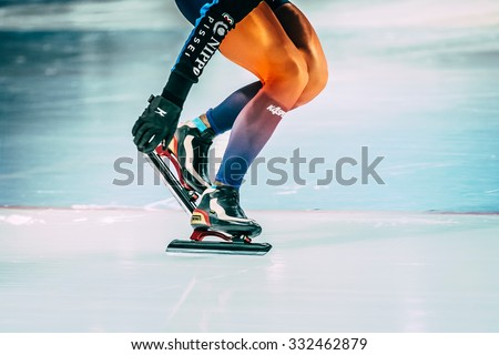 Chelyabinsk, Russia - October 15, 2015: girl athlete speed skating shoveling snow with skate blades during Cup of Russia on speed skating - stock photo