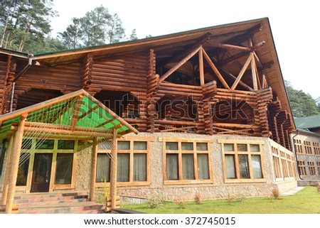 "Chemal, Russia - October 5, 2014: The wooden building of the hotel ""Marin Island"" in the village of Chemal, Altai Mountains, Siberia"