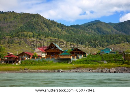 Chemal town at riverside of Katun river. Altai, Siberia - stock photo