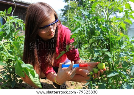 chemical agriculture, a young beautiful girl - stock photo