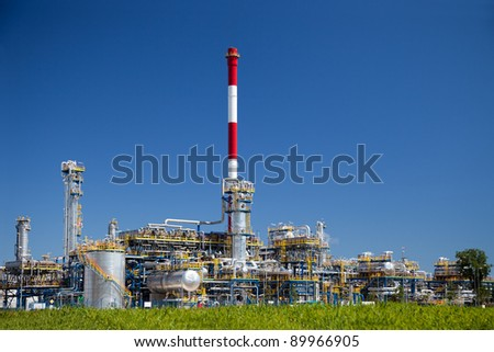 Chemical and oil refinery against blue sky. - stock photo