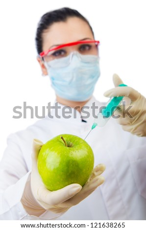 Chemical experiment with apple and syringe