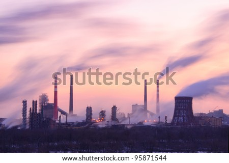 Chemical factory in the evening, with lights and smoke, long exposure - stock photo