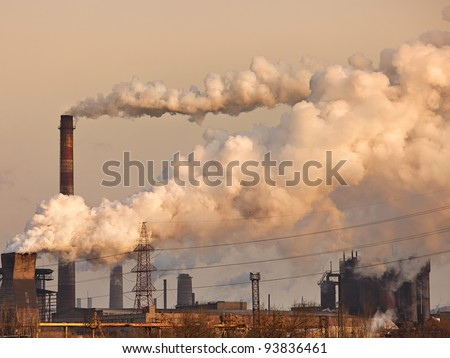 Chemical factory with smoke stack - stock photo