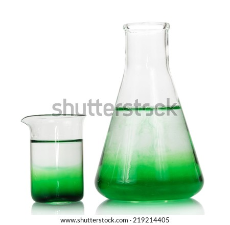 Chemical flasks with green liquid isolated on white
