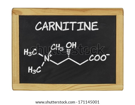 chemical formula of carnitine on a blackboard - stock photo