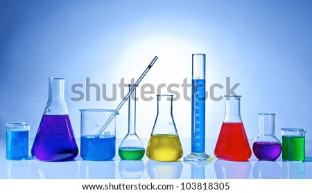 Chemical glassware with colored liquids inside bottles