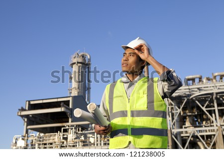 chemical industrial engineer with large oil refinery background - stock photo