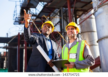 chemical industrial manager and senior worker at petrochemical plant - stock photo