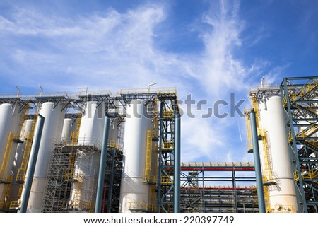 chemical Industrial Plant against the blue sky and cloud - stock photo