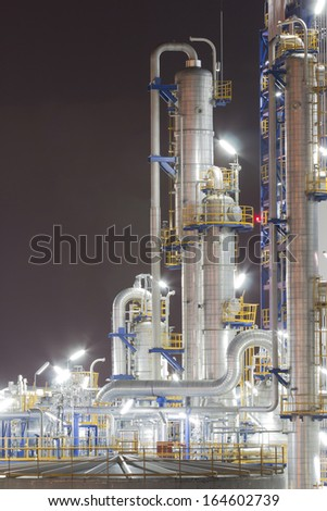 Chemical industrial plant in night time - stock photo