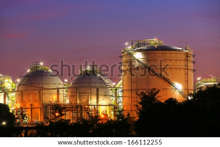 Chemical industrial storage sphere tanks at twilight time - stock photo