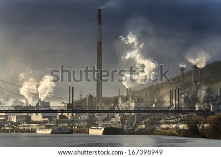 Chemical industries generating pollution. Some chimneys with smoke. Landscape and nobody - stock photo