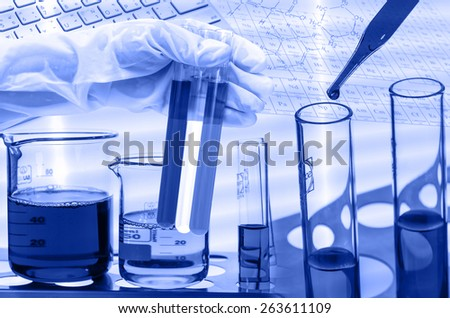 Chemical Laboratory,scientist dropping the reagent into test flask and tube - stock photo