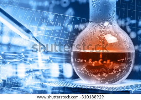 chemical liquid in round bottom flask with dropper and test tubes  - stock photo