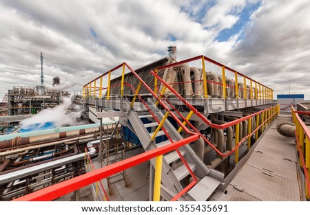 Chemical plant for production of ammonia and nitrogen fertilization on day time. The cooling system of ammonia - stock photo