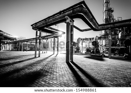 Chemical plant pipeline at night - stock photo