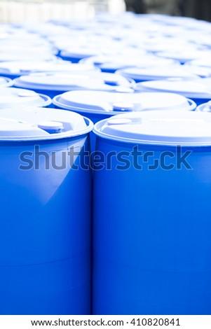 Chemical Plant, Plastic Storage Drums, Big Blue Barrels - stock photo