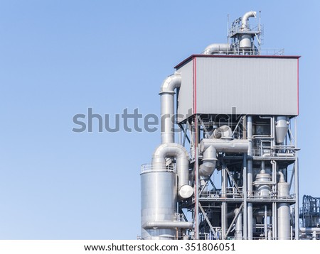 Chemical plant tower. Tank and pipes. Copy space