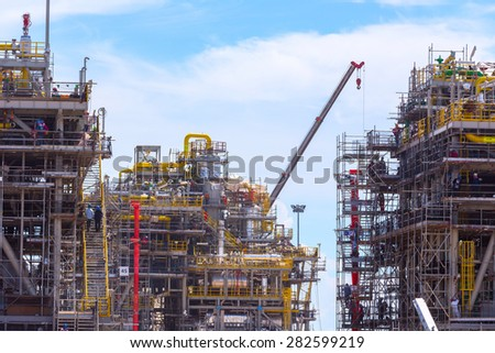 Chemical plant under construction with worker - stock photo