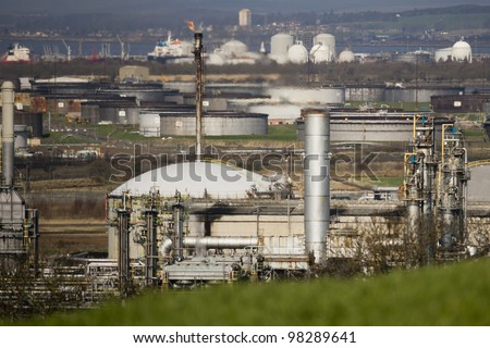 Chemical plant with flare chimneys and heat haze. - stock photo