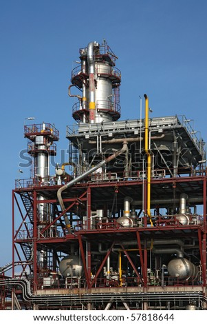 chemical refinery steel factory structure under sky - stock photo