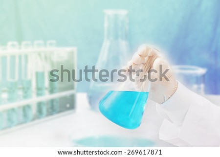 chemical research at science lab  - stock photo