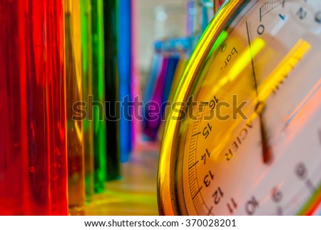 Chemical science with colors and glassware surrounded by manometer. - stock photo