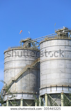 Chemical silo in refinery plant with blue sky