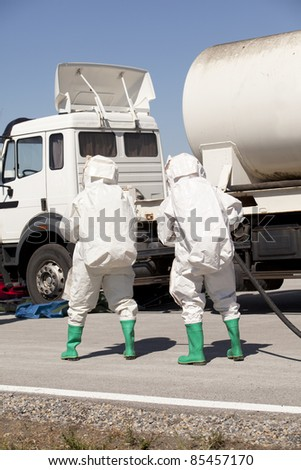 Chemical spill after road accident - stock photo