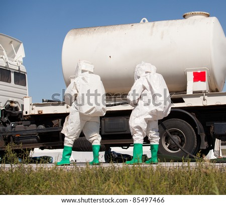Chemical spill after traffic accident - stock photo