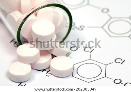 Chemical Structure and Pink tablets of Certain Kind of Medicine in New Drug Discovery Concept and Pharmaceutical Technology. - stock photo