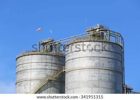 Chemical tank container with blue sky