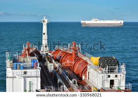 chemical tanker at sea during crossing situation withh ro-ro vessel